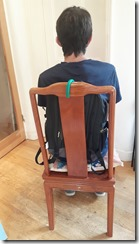 Client sitting against the backpack containing the air cushion